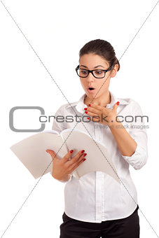 Surprised business woman holding magazine