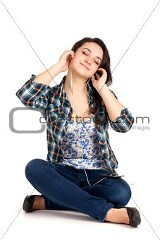Blond teenage girl sitting and listen music