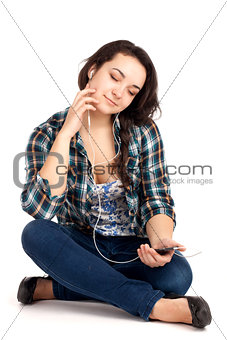 Teenage girl sitting and listen music