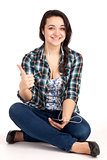 Teenage girl sitting and listen music