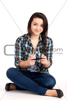Teenage girl sitting and playing games