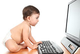 Baby typing on a computer keyboard