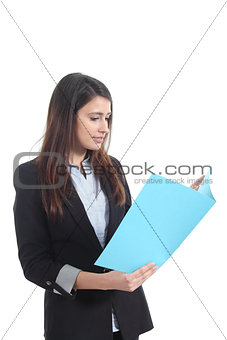 Beautiful businesswoman reading a report