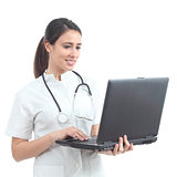 Beautiful nurse typing in a laptop