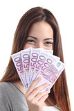 Woman holding five hundred euro banknotes