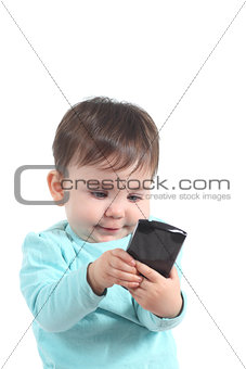 Baby playing with a mobile phone