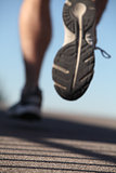 Unfocused man shoes running on the asphalt