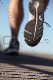 Unfocused man shoes running on the asphalt