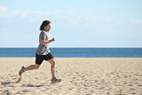 Man running fast on the beach