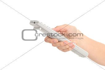 Beautiful woman hand with a tv remote control