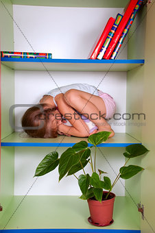 little girl hugging a toy and hiding in a closet