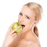 Beautiful girl is biting fresh apple