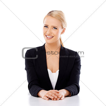 Beautiful smiling business woman sitting at the desk