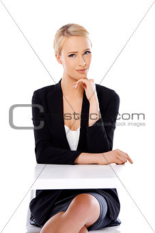 Adorable blond business woman sitting at desk