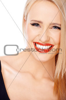 Portrait of smiling blond cute woman with red lipstick