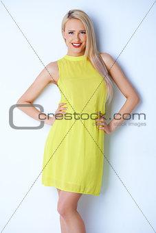 Beautiful blond woman wearing lemon dress