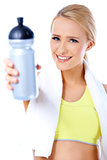 Cute sporty blond woman holding water bottle