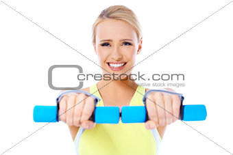 Close up of fit woman while exercise with dumbbells