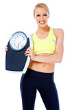Smiling woman holding a waight scale