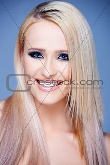 Blond sexy woman with straight long hair