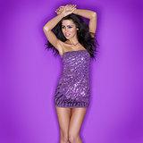 Beautiful woman in sexy purple miniskirt