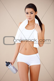 Portrait of brunette woman after fitness