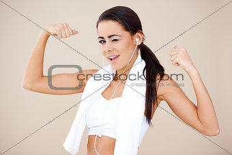 Attractive female showing her biceps