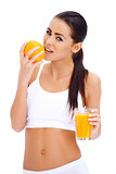 Woman holding glass of fresh orange and glass of juice