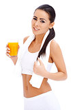 Woman holding glass of fresh orange juice