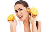 Woman with fresh orange halfs in her hands
