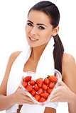 Woman holding heart shaped box of strawberries