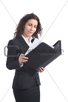 Beautiful mature businesswoman reading a report