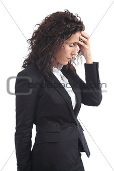 Beautiful mature businesswoman stressed with a headache