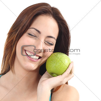 Beautiful woman holding an apple close to her face