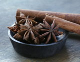Stars anise on a wooden   plate