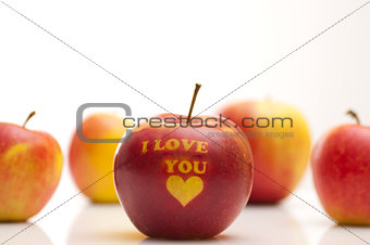 apple with the words  I LOVE YOU arranged in a row