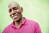 Portrait of elderly black man looking and smiling at camera