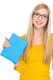 Portrait of happy student girl in glasses holding book