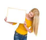 Student girl looking on blank board