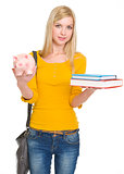 Student girl showing books and piggy bank