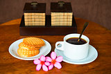 Tropical coffee with cookies