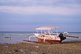 Indonesian boat on beach at low tide