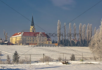 Greek catholic cathedral in snow landscape