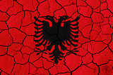 Flag of Albania over cracked background