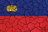 Flag of Liechtenstein over cracked background