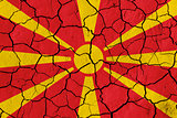 Flag of Macedonia over cracked background