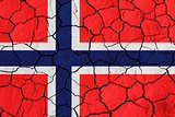 Flag of Norway over cracked background