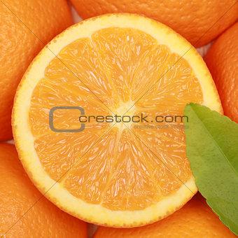 Sliced orange with a leaf
