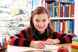 Girl smiling while doing homework