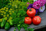 Fresh vegetables and flowers still life